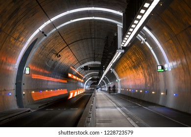Bus driving in a tunnel for public transports, cyclist and pedestrians. Lyon, France.