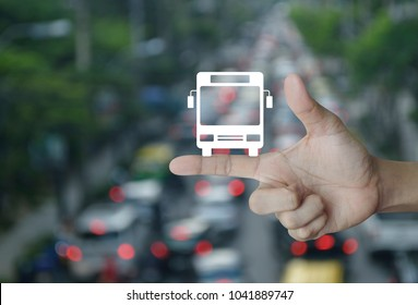 Bus flat icon on finger over blur of rush hour with cars and road, Business transportation service concept