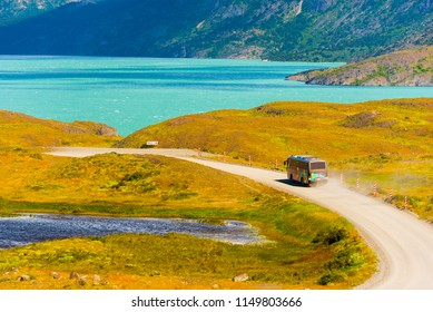 The bus goes on the road, Torres del Paine National Park, Patagonia, Chile, South America. Copy space for text
