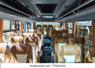 The bus inside. Brown leather seats in the rear compartment.