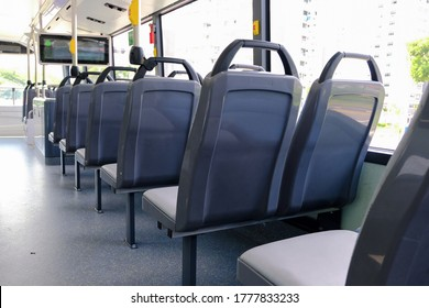 Bus interior: back view of seats on empty double decker bus. Blank advertising space; for mockup display; seat sticker wrap. - Shutterstock ID 1777833233