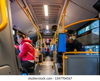 Bus interior with passengers travelling with public transportation in Cluj-Napoca, Romania, March 23, 2019