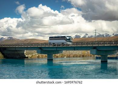 Bus on a bridge over Lake Pukaki