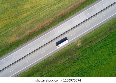 Bus on road drone above view. Theme of passenger transportation.