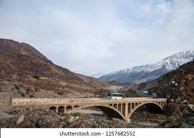 A bus is passing over the bridge on the Karakoram Highway