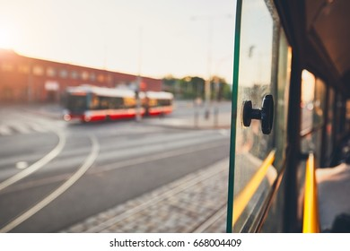 Bus of the public transportation at the sunset. Selective focus on the window of the tram.