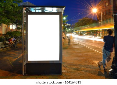 Bus Shelter Billboard at Night