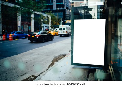Bus station billboard with blank copy space screen for advertising text message or promotional content, empty mock up Lightbox for information, stop shelter clear poster display in urban city street
