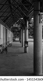 Bus station r at 18:00:00 in black and white. Concept of adventure and traveling to new places.