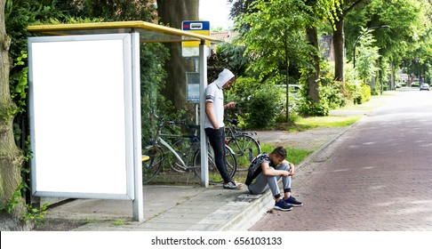 Bus stop abri or billboard mockup with teens hanging around