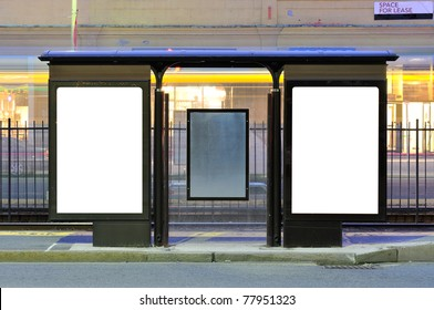 Bus Stop Advertising. Two blank billboards in city street at night