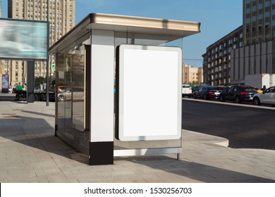 Bus stop in city center near administrative buildings. Parking lot for office workers in background. Blank vertical billboard and digital screen for advertising campaigns to boost sales and promote.