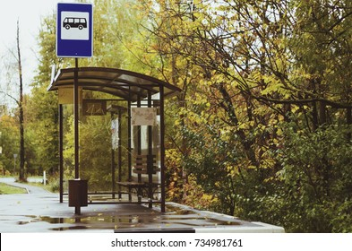 Bus stop near the road in the autumn