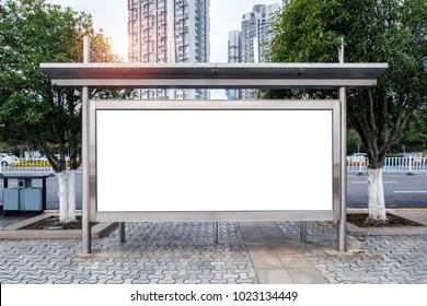 Bus stop on city road edge Blank billboard