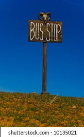 Bus stop post against blue sky.
