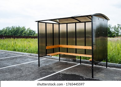 bus stop in a rural village, made of brown polycarbonate, outdoors