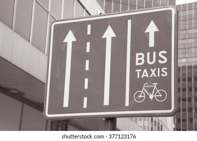 Bus, Taxi and Bicycle Traffic Sign in Urban Setting in Black and White Sepia Tone