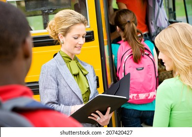 Bus: Teacher Checking Off Students At Field Trip