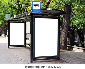 Bus tram stop, shelter, white empty place for street ads, advertisement board, mock up, mockup, signage, bus stop. Vertical blank white billboard at bus stop on city street. In the background park.