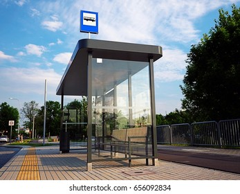 Bus tram stop, shelter, white empty place for street ads, advertisement board, mock up, mockup, signage, city, rails, rail station on glass.