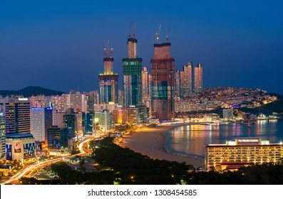 Busan beach view from roof top Busan city in night time with blue sky and full moon, South Korea, this picture can use for tavel, Busa, South Korea and  city concept