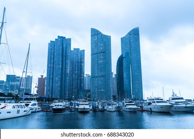 Busan city skyline view with cloudy at Haeundae district, Yacht parking at modern building architecture Haeundae beach, Busan, South Korea