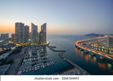 Busan city skyline view at Haeundae district, Gwangalli Beach with yacht pier at Busan, South Korea. Ariel view.