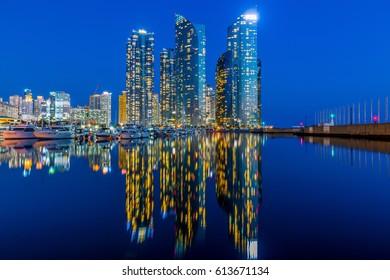Busan city skyline view at Haeundae district, Yacht parking at modern building architecture Haeundae beach, Busan, South Korea