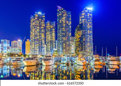 Busan city skyline view at Haeundae district, Gwangalli Beach, Yacht parking at modern building architecture Haeundae beach, Busan, South Korea