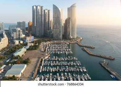 Busan city skyline view at Haeundae district, Gwangalli Beach with yacht pier at Busan, South Korea.