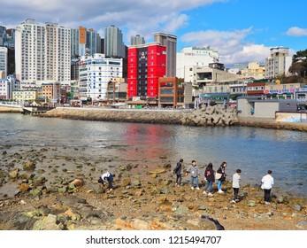Busan, Korea, October 27, 2018: People are walking on the beach of Songdo skywalk at songdo beach in Busan City,The longest skywalk on the water