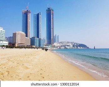 Busan, KR - JANUARY 8, 2019: Scenery of Haeundae Beach, one of the famous beautiful attractions in Busan that have three skyscrapers as background.