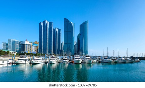 Busan marina with yachts, Marina city skyscrapers with reflection on sunset, South Korea