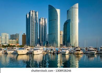 Busan marina with yachts, Marina city skyscrapers with reflection, South Korea