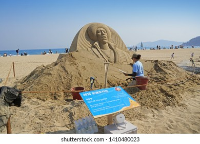 """Busan / Republic of Korea - May 24, 2019 : Sand sculptures """"God of the guitar-Jimi Hendrix"""" created by artist """"Sue mcgrew"""" at Haeundae Sand Festival 2019 takes place at the sunny beaches of Busan."""