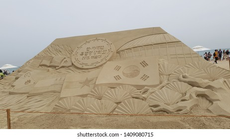 "Busan / Republic of Korea - May. 25, 2019 : People enjoyed the ""Haeundae Sand Festival"" at Haeundae Beach in Busan, Korea. It is the eco-friendly festival with sand in Korea."