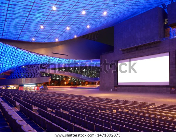 Busan, South Korea - 1 April, 2019: Movie theater with empty seats and blank screen at Busan Cinema Center. Busan Cinema Center is the official venue of the Busan International Film Festival (BIFF).
