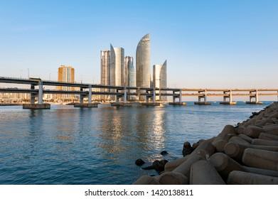 Busan, South Korea - April 2019: Cityscape with luxurious skyscrapers of Marine City in Haeundae District and Gwangandaegyo Bridge or Diamond Bridge in Busan, South Korea