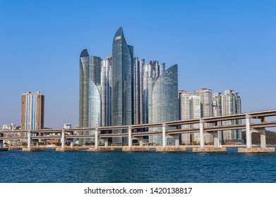 Busan, South Korea - April 2019: Cityscape with luxurious skyscrapers of Marine City in Haeundae District and Gwangandaegyo Bridge or Diamond Bridge in Busan, South Korea