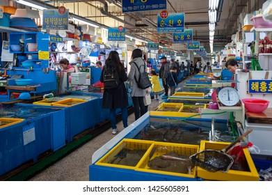 Busan, South Korea - April 2019: Fresh seafood sold at Millak Raw Fish Market located near Gwangalli Beach in Busan, South Korea