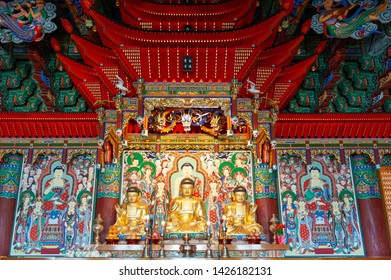 Busan, South Korea - April 2019: Buddha images in hall of Haedong Yonggungsa, Buddhist temple, one of tourist landmarks and attractions in Busan, South Korea