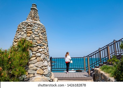 Busan, South Korea - April 2019: Stone stupa at Haedong Yonggungsa Temple, a Buddhist temple situated on seaside of north-eastern Busan, one of tourist landmarks and attractions in Busan, South Korea
