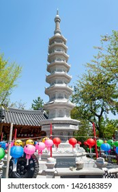 Busan, South Korea - April 2019: Stone pagoda at Haedong Yonggungsa Temple, a Buddhist temple situated on seaside of north-eastern Busan, one of tourist landmarks and attractions in Busan, South Korea