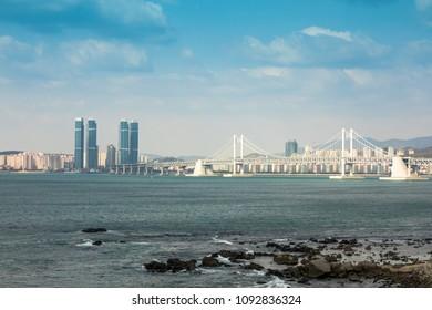 Busan, South Korea - APRIL 7, 2018:Cityscape with Gwangandaegyo or Diamond Bridge, suspension bridge and sea in morning time.