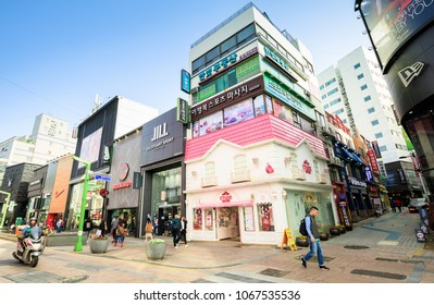BUSAN ,SOUTH KOREA - APRIL 8,2018 : The many cosmetic shops and people are in down town of Busan.