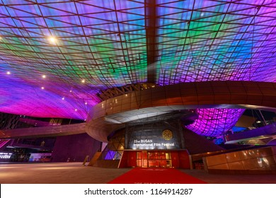 """Busan, South Korea - Aug 20, 2018 : Roof full of LED lights viewed from below and exterior of the Busan Cinema Center (also called """"Dureraum"""") in Busan city"""