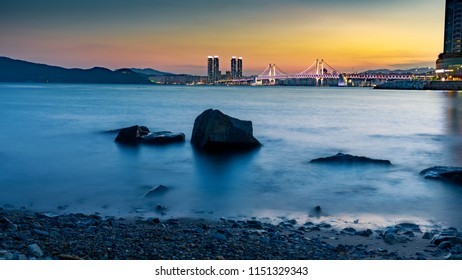 Busan, South Korea - Aug 8, 2018 : Gwangan bridge light up and beautiful twilight sky, sunset at Haeundae in Busan city