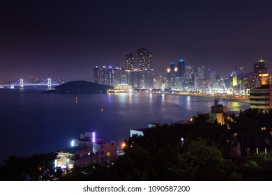 Busan, South Korea - August 22, 2014: The view of Haeundae beach and Haeundae City skyscrapers at night on 22 August 2014, Busan, South Korea.
