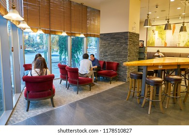 BUSAN, SOUTH KOREA - CIRCA MAY, 2017: inside Starbucks coffee shop in Busan. Starbucks Corporation is an American coffee company and coffeehouse chain.