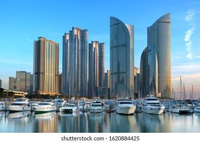 Busan / South Korea - December 14 2019 : Skyscrapers of modern apartment buildings and yacht marina in Marine City of Busan, South Korea